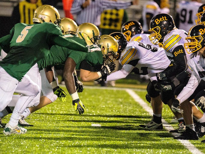 Iowa City West and Bettendorf jump off the line during the first half of play in Iowa City on Friday, October 3, 2014.