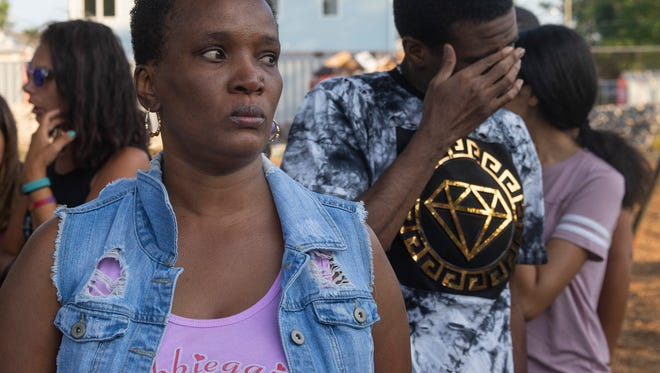 Carol Bennett and her son Chad try to keep it together as they attend the vigil for their daughter/sister Abbiegail Smith. Vigil for Abbiegail Smith on the one year anniversary of her murder in Keansburg, NJ, on  July 13, 2018.