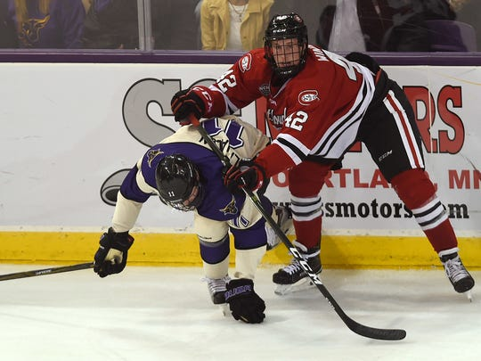 St. Cloud State's Blake Winiecki (42) pushes Minnesota State-Mankato's Sean Flanagan down during Friday's game at Verizon Wireless Center in Mankato. Winiecki will be one of four St. Cloud State players from Lakeville to play against three Gophers from Lakeville this weekend.
