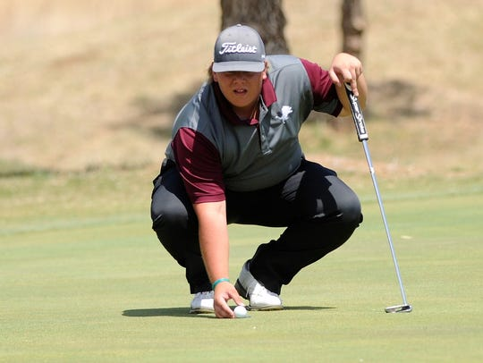 Brownwood's Jaryn Pruitt lines up a putt during the second day of the Region I-4A tournament at the Shadow Hills Golf Club on April 24. Pruitt finished second overall and was the top individual medalist to qualify for state.