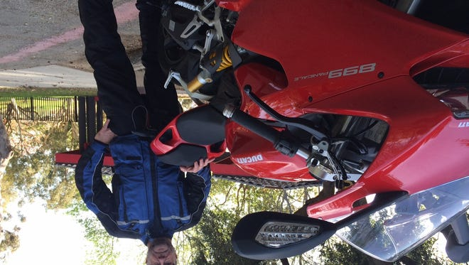 USA TODAY's William Welch reviews the 2014 Ducati 898 Panigale, a light and agile Italian superbike that's street capable, with gobs of power and light handling.