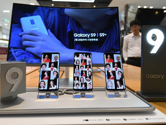 A man walks past a display for Samsung Galaxy S9 smartphones