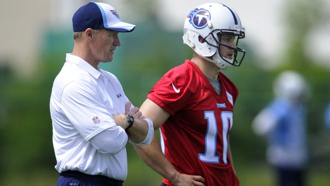 Titans head coach Ken Whisenhunt will watch quarterback Jake Locker, right, throw on Tuesday.