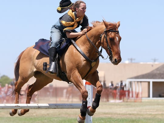 SPC Autumn Ehler takes her run during the jumping portion of the U.S. Cavalry Association's regional competition at Fort Concho on in 2016.