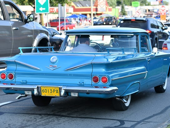 A 1960 El Camino, with little railings in the cargo