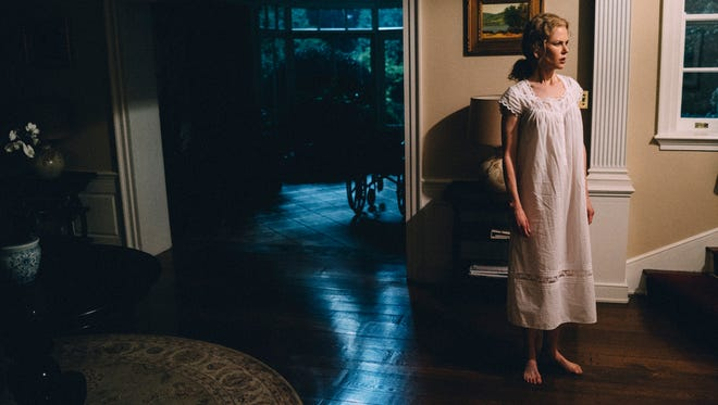 "Anna (Nicole Kidman) hears something in ""The Killing of a Sacred Deer."""