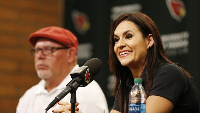 Dr. Jen Welter is introduced during a press conference by Arizona Cardinals coach Bruce Arians at the team's training facility in Tempe July 28, 2015. She is the first female coach in the NFL and will be a Cardinals coaching intern for training camp and the preseason.