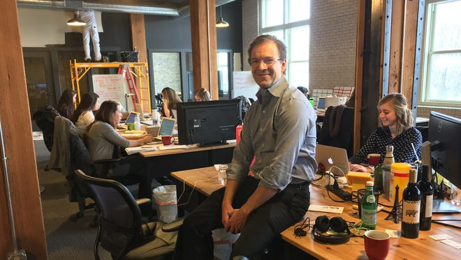 Chris Abele sits in the offices of Bright Cellars, a technology-driven subscription wine club, at the Ward4 co-working center in Milwaukee. Abele, the Milwaukee County executive, is a big supporter of the region's start-up community.