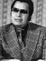 This Jan. 1976 photo shows the Rev. Jim Jones, pastor of Peoples Temple in San Francisco. Dozens of Peoples Temple members in Guyana survived the mass suicides and murders of more than 900 because they had slipped out of Jonestown or happened to be away Nov. 18, 1978. Those raised in the temple or who joined as teens lost the only life they knew.