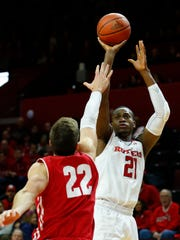 Rutgers Scarlet Knights forward Mamadou Doucoure (21) shoots over Wisconsin Badgers forward Ethan Happ (22)