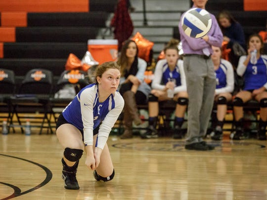 Croswell-Lexington's Laurel Shaw digs the ball during a volleyball game Thursday, Oct. 27, 2016, at Armada High School.