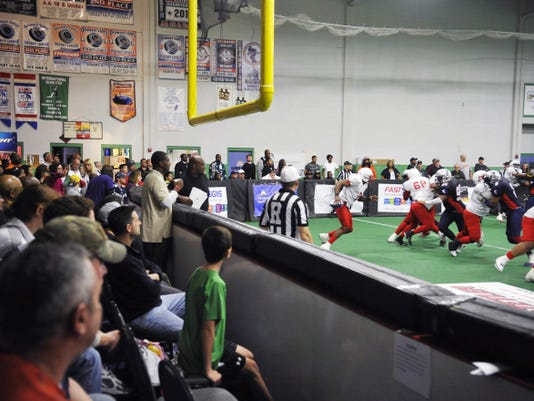 Fans watch the York Capitals' inaugural game at the York City Ice Arena in April 2013. The Capitals have advanced to this season's American Indoor Football championship game, set for 7 p.m. Saturday against the Chicago Blitz. The ice arena will host the title game after drying out from a burst pipe that flooded parts of the arena during last weekend's semifinal.