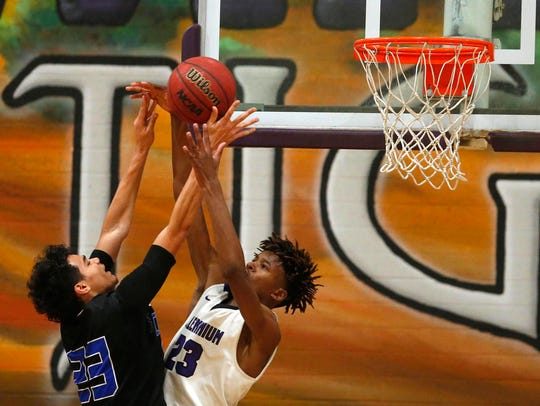 Chandler's Jacquez Barrow (23) goes up for a basket