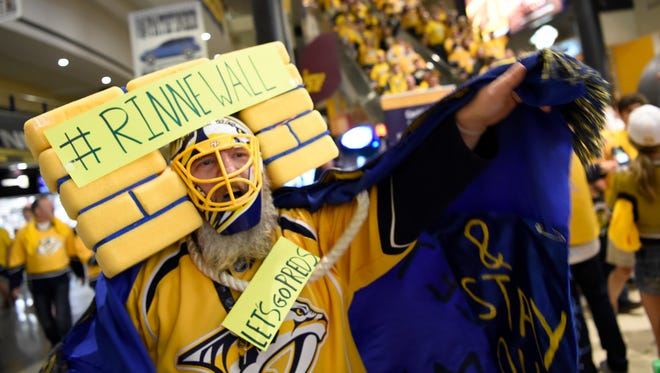 Predators fan Douglas Berg celebrates the overtime win in Game 3 on Tuesday at  Bridgestone Arena.