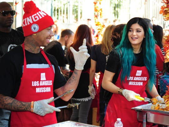 Kylie Jenner joins reported boyfriend, rapper Tyga, as they serve up Thanksgiving dinner to the homeless at the Los Angeles Mission in downtown Los Angeles.