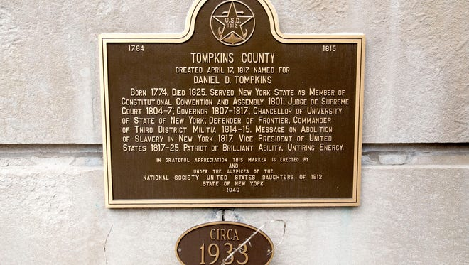 A plaque beneath the entry stairwell of the Tompkins County Courthouse. Meant to commemorate the birthdate of Tompkins County, the plaque actually shows the wrong date; April 17, 1817 is ten days later than the date the county was founded.