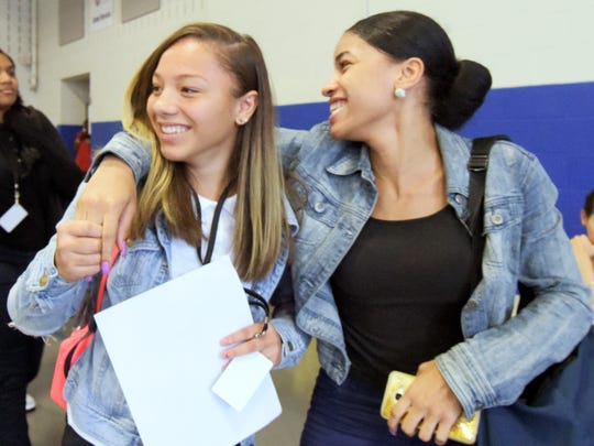 Helen Thackston Charter School sophomores Nyceyah Foster, left, and Shante Grant walk through the cafeteria on the first day of classes Monday, Aug. 28, 2017. Bill Kalina photo