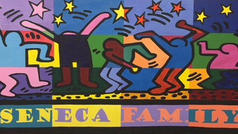 The Seneca Family mural was created by multiply disabled students at Seneca High School with assistance from other students.