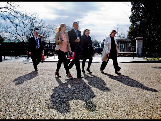 President Barack Obama, center, walks out of the White