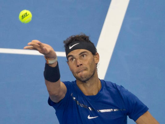 Rafael Nadal of Spain serves a shot from Grigor Dimitrov of Bulgaria during a men's singles semi-final match in the China Open tennis tournament at the Diamond Court in Beijing, China, Saturday, Oct. 7, 2017. (AP Photo/Ng Han Guan)