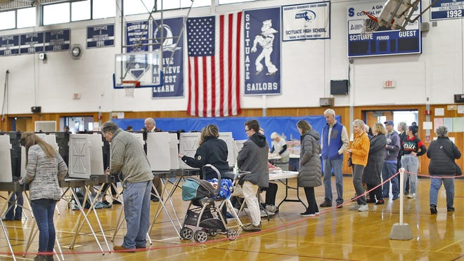 Scituate residents vote at the high school gym on Tuesday March 3, 2020. Greg Derr/The  Patriot Ledger