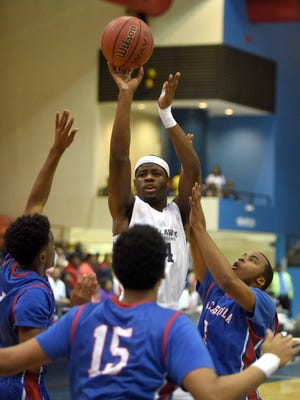 Callaway's Malik Newman drains a three despite a Pascagoula triple team on Wednesday, March 4, 2015, in the MHSAA state basketball tournament at the Lee E. Williams Athletics & Assembly Center on the Jackson State University campus in Jackson, Miss.