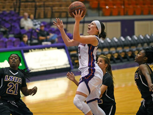 Northwestern State guard Beatrice Attura (30) attempts a layup against LSUA Saturday.