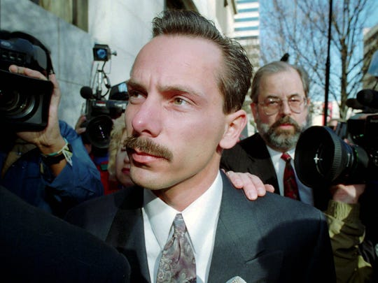 Jeff Gillooly, ex-husband of U.S. Figure Skating champion Tonya Harding, arrives at Multnomah County District Court, followed by his lawyer Ron Hoevet, Tuesday, Feb. 1, 1994, in Portland, Ore., where he pleaded guilty to his role in the attack on Nancy Kerrigan.