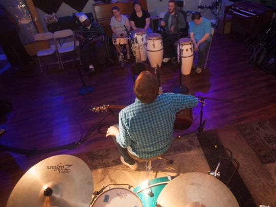 Jim Gaven, music director at Allies, Inc.,  plays and