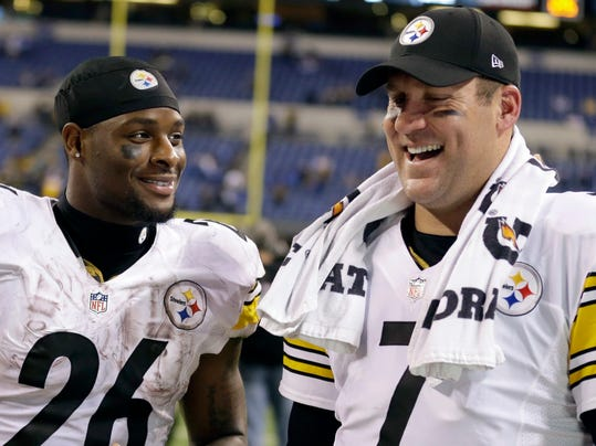 FILE - In this Nov. 24, 2016, file photo, Pittsburgh Steelers quarterback Ben Roethlisberger (7) and running back Le'Veon Bell (26) talk following an NFL football game against the Indianapolis Colts, in Indianapolis. Four years in, Roethlisberger is still waiting for running back Le'Veon Bell to get tired. Bell's versatility and seemingly eternally fresh legs have made him indespensible to Pittsburgh's offense, one of the reasons Roethlisberger calls Bell the best back in the NFL.  (AP Photo/Michael Conroy, File)