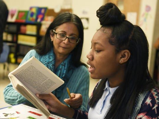 Sheeba Cheriyan helps ninth-grader A'Sharia, 14, work on her reading last month at Mumford Academy.