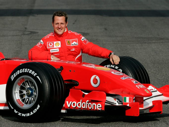 Michael Schumacher poses with the new Ferrari Formula One race car 248 F1 during the official presentation at the Mugello racetrack in Scarperia, central Italy, in this Jan. 24, 2006 file photo.  The Formula One great who sustained severe head injuries in a ski accident in late 2013, is no longer in a coma and has left the French hospital where he was being treated since the accident, his spokeswoman said on June 16, 2014.