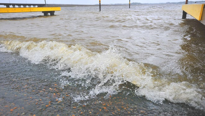 Waves splash along the Pelahatchie Shore Park boat ramp on the Ross Barnett Reservoir in 2012.