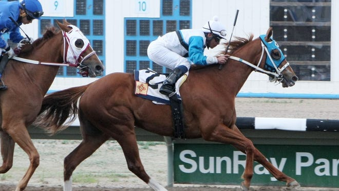 Atillas Gift, ridden by Norberto Arroyo Jr., pulls clear of D E Lover in the shadow of the wire on his way to victory in the $44,800 Jack Cole Handicap at SunRay Park and Casino in Farmington.