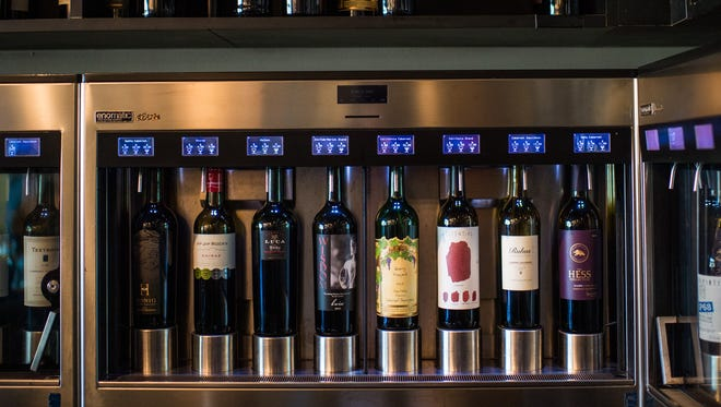 At POUR, customers can purchase cards with monetary value and swipe them to dispense wines from machines.