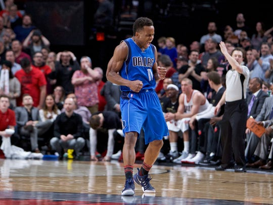 Dallas Mavericks guard Yogi Ferrell reacts after making a 3-point basket against the Portland Trail Blazers during the second half of an NBA basketball game in Portland, Ore., Friday, Feb. 3, 2017.