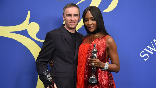 Raf Simons of Calvin Klein, winner of the CFDA Awards' womenwear designer category, poses with Naomi Campbell, winner of the fashion icon award.
