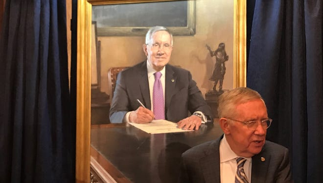 U.S. Sen. Harry Reid, D-Nev., with his leadership portrait on Dec. 12, 2016. Reid unveiled his portrait before he left office.