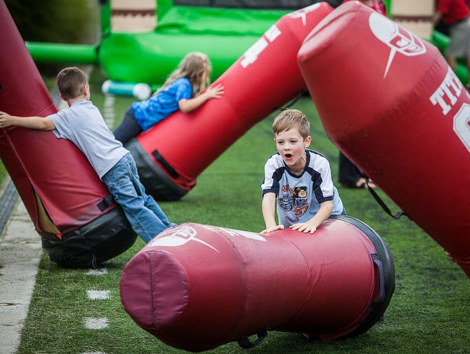 Despite rainy weather, dozens attended Fan Jam at Scheumann Stadium Friday evening for food, games and to mingle with Ball State's student athletes.