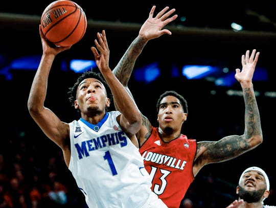 Memphis guard Jamal Johnson (left) drives for a layup