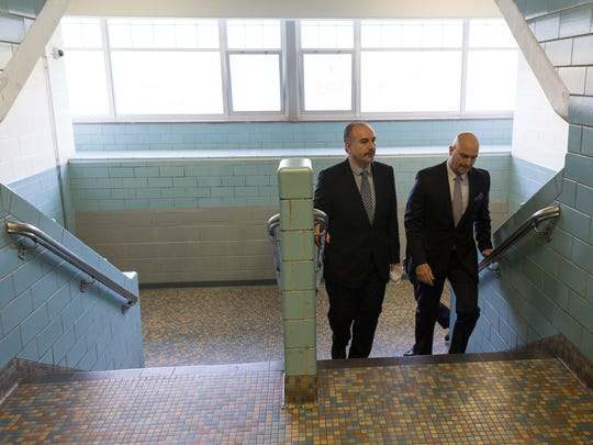 Henry Ford High School Principal Michael Mokdad, left, walks through Henry Ford High School with Detroit School District Superintendent Nikolai Vitti on Wednesday, May 9, 2018 in Detroit. Detroit School District Superintendent Nikolai Vitti has spent one year in this position.