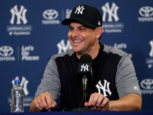 Yankees manager Aaron Boone speaks during a news conference at baseball spring training camp, Tuesday, Feb. 13, 2018, in Tampa, Fla.