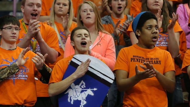 Basketball fans from Bondurant-Farrar cheer during the 2014 state tournament at Wells Fargo Arena.