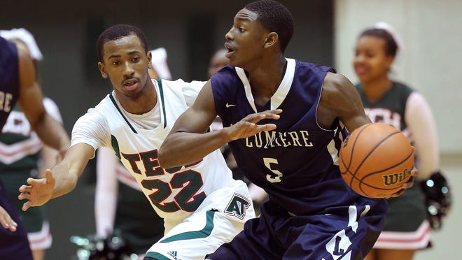 Tech's Jermaine Tyler,left, defends La Lumiere's Jalen Coleman,right, in the first half of their game. Arsenal Tech High School played La Lumiere High School Wednesday evening at Arsenal Tech High School.