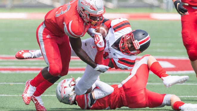 Northwest's Anthony Grossnickle helps to bring down Orrville's Marquael Parks during the Indians' Week 1 win.