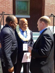 South African Ambassador Mninwa Mahlangu (left), Congressman John Lewis, D - Ga. (center) and Senator Chris Coons (right) in Selma, Alabama on the 50th anniversary of Bloody Sunday.