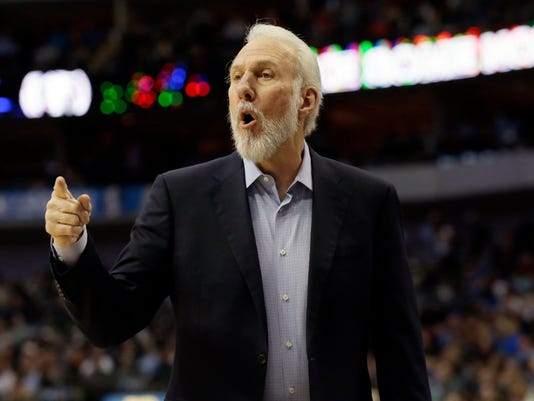 San Antonio Spurs head coach Gregg Popovich makes a point from the sideline during the first half of an NBA basketball game against the Dallas Mavericks in Dallas, Friday, April 7, 2017. (AP Photo/LM Otero)