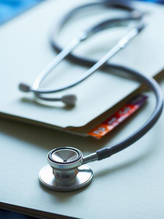 Stethoscope on medical charts