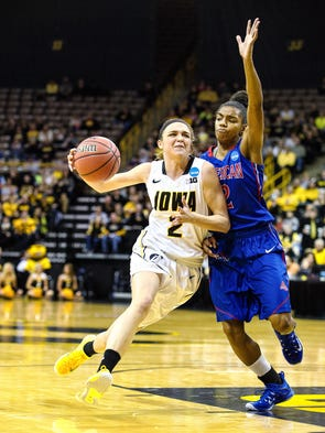 Iowa's Aly Disterhoft drives into the lane as American's
