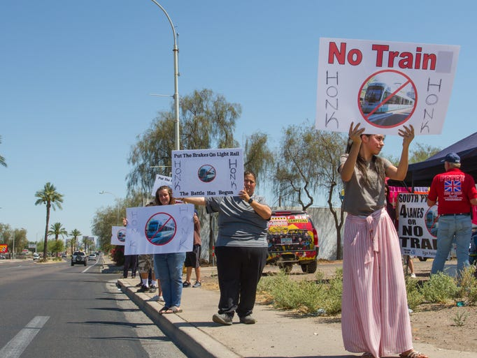 A dozen protesters rallied on Central Avenue in south